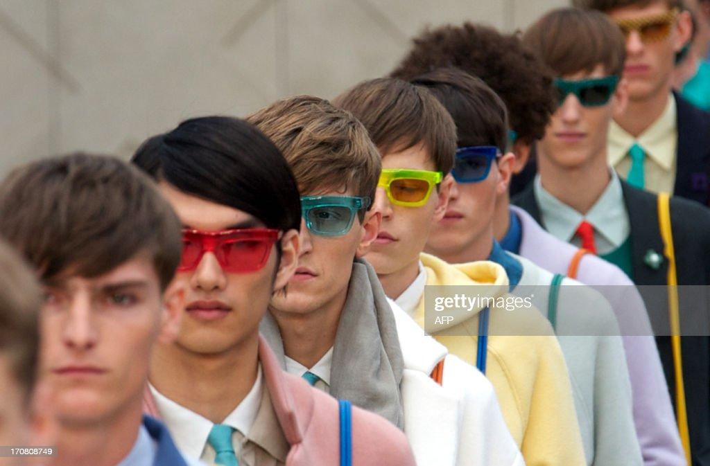 Models present creations by Burberry Prorsum during the Spring/Summer 2014 London Collections: Men fashion event in London on June 18, 2013. AFP PHOTO/ANDREW COWIE