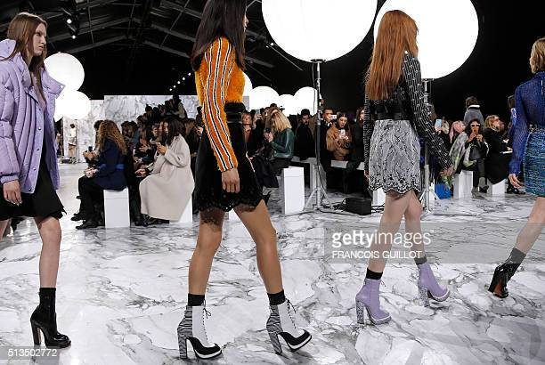 Models present creations by Carven during the 20162017 fall/winter readytowear collection fashion show on March 3 2016 in Paris AFP PHOTO / FRANCOIS...