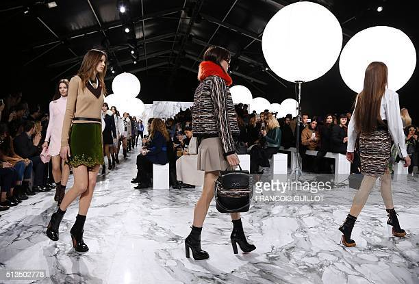 TOPSHOT Models present creations by Carven during the 20162017 fall/winter readytowear collection fashion show on March 3 2016 in Paris / AFP /...