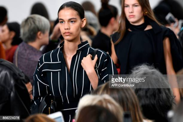 Models present creations by Celine during the women's 2018 Spring/Summer readytowear collection fashion show in Paris on October 1 2017 / AFP PHOTO /...