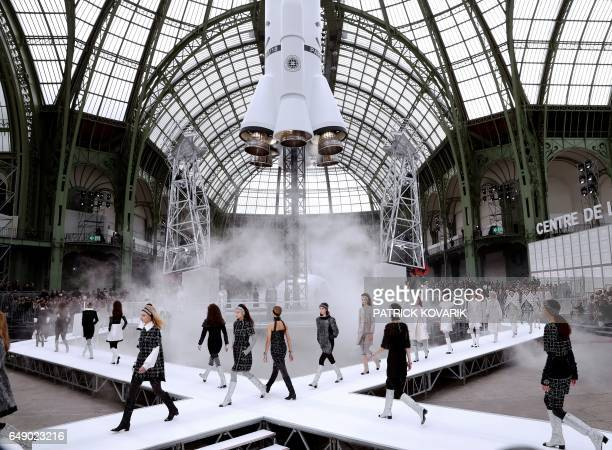 TOPSHOT Models present creations by Chanel during the women's FallWinter 20172018 readytowear collection fashion show at the Grand Palais in Paris on...