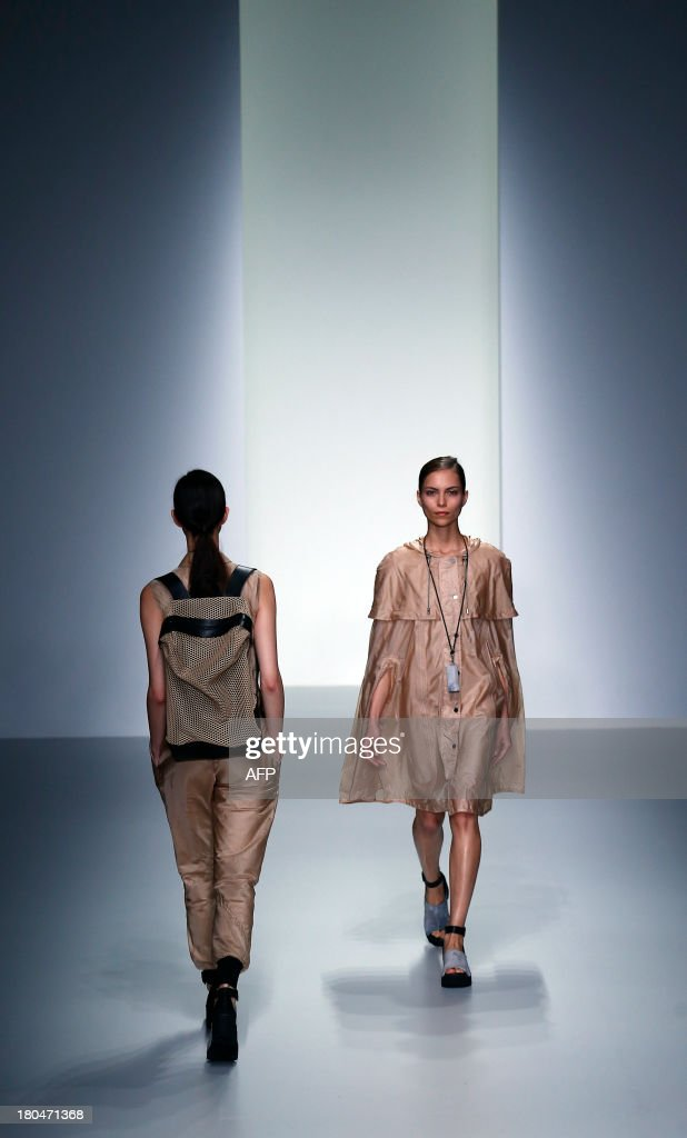 Models present creations by Christopher Raeburn during the 2014 Spring/Summer London Fashion Week in London on September 13, 2013.