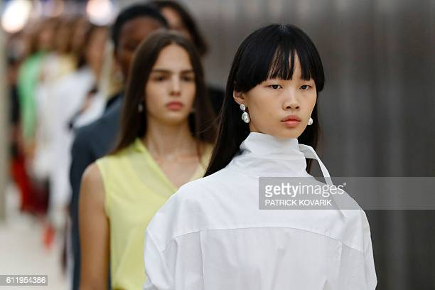 Models present creations by Céline during the 2017 Spring/Summer readytowear collection fashion show on October 2 2016 in Paris / AFP / PATRICK...