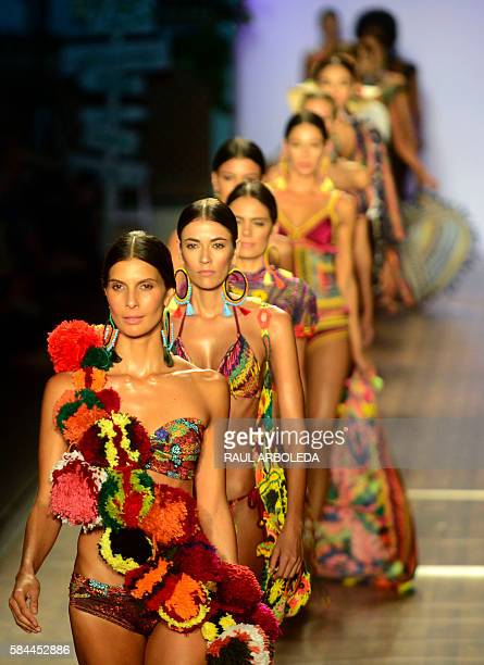 Models present creations by Colombian brand Agua Bendita during the Colombiamoda fashion show in Medellin Antioquia department Colombia on July 28...