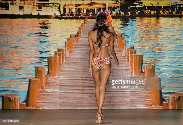 Models present creations by Colombian brand Paradizia during the Colombiamoda fashion show in Medellin Antioquia department Colombia on July 29 2015...