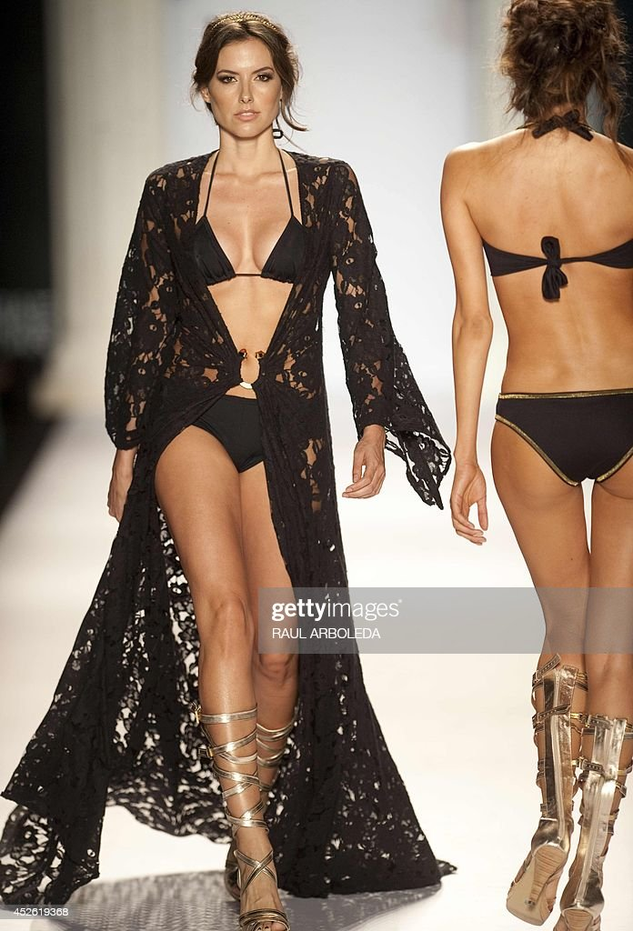 Models present creations by Colombian designer Carmen Belissa during the Colombiamoda fashion show in Medellin, Antioquia department, Colombia, on July 24, 2014. AFP PHOTO/Raul ARBOLEDA