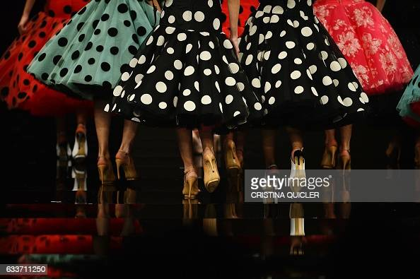TOPSHOT Models present creations by Cristina Garcia during the SIMOF 2017 in Sevilla on February 3 2017 / AFP / CRISTINA QUICLER