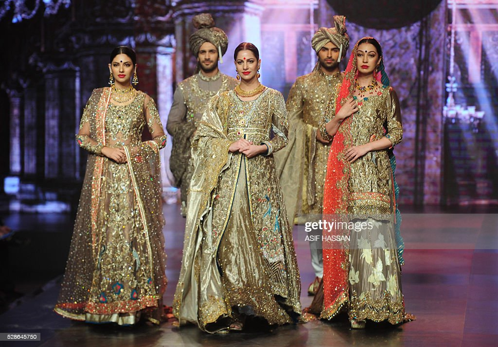 Models present creations by designer Mohsin Naveed Ranjha on the first day of Bridal Couture Week-Gold Edition in Karachi on May 6, 2016. / AFP / ASIF