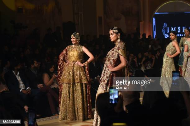 Models present creations by designer Umsha by Uzma Babar on the last day of the Pantene Hum Bridal Couture Week in Lahore on December 10 2017 / AFP...