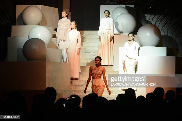 Models present creations by fashion designer Annika Fernando at the Colombo fashion week on March 18 2017 / AFP PHOTO / LAKRUWAN WANNIARACHCHI