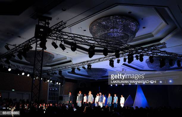 Models present creations by fashion designer Fouzul Hameed at the Colombo fashion week in Colombo on March 17 2017 / AFP PHOTO / LAKRUWAN...