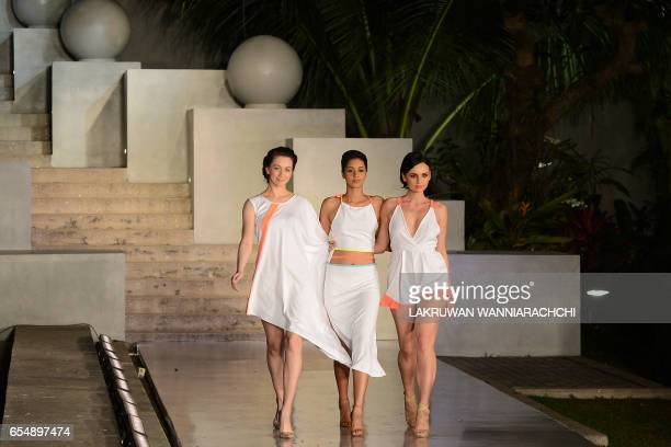 Models present creations by fashion designer Mihiri de Silva at the Colombo fashion week on March 18 2017 / AFP PHOTO / LAKRUWAN WANNIARACHCHI