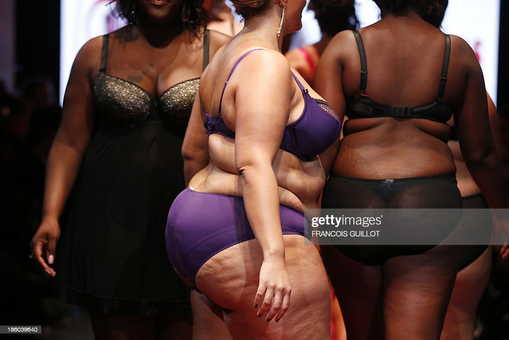 Models present creations by 'Femmes fabuleuses' during the first Pulp fashion week, on October 27, 2013 in Paris.