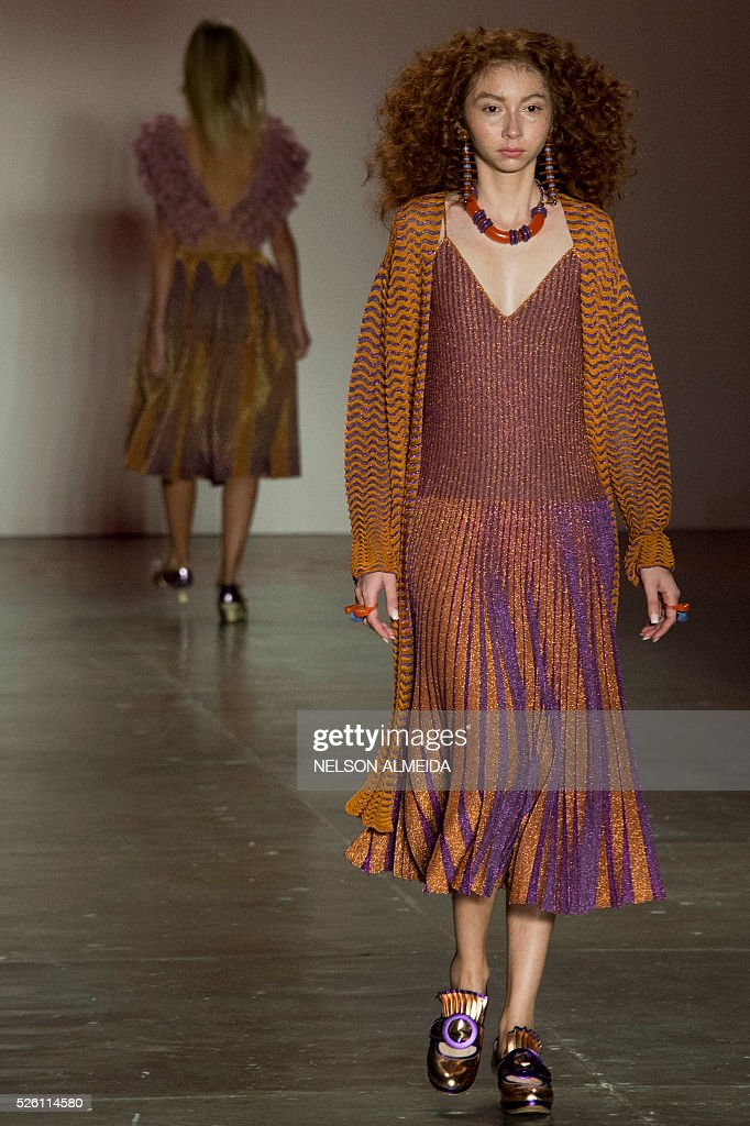 Models present creations by Gig Couture during the 2017 Summer collections of the Sao Paulo Fashion Week in Sao Paulo, Brazil on April 29, 2016. / AFP / NELSON