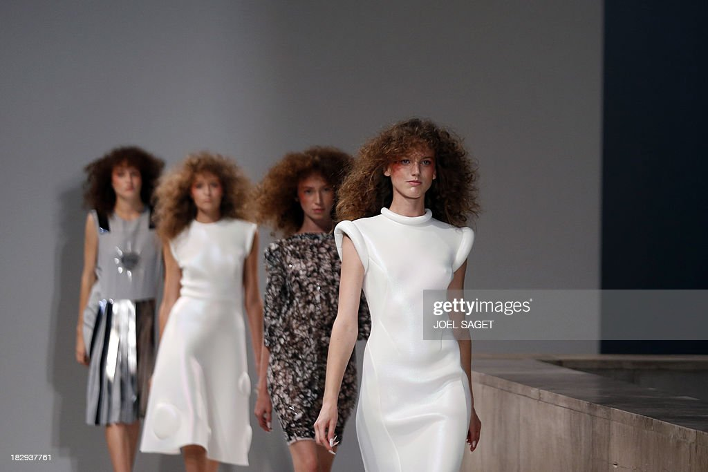 Models present creations by Gosia Baczynska during the 2014 Spring/Summer ready-to-wear collection fashion show, on October 2, 2013 in Paris.