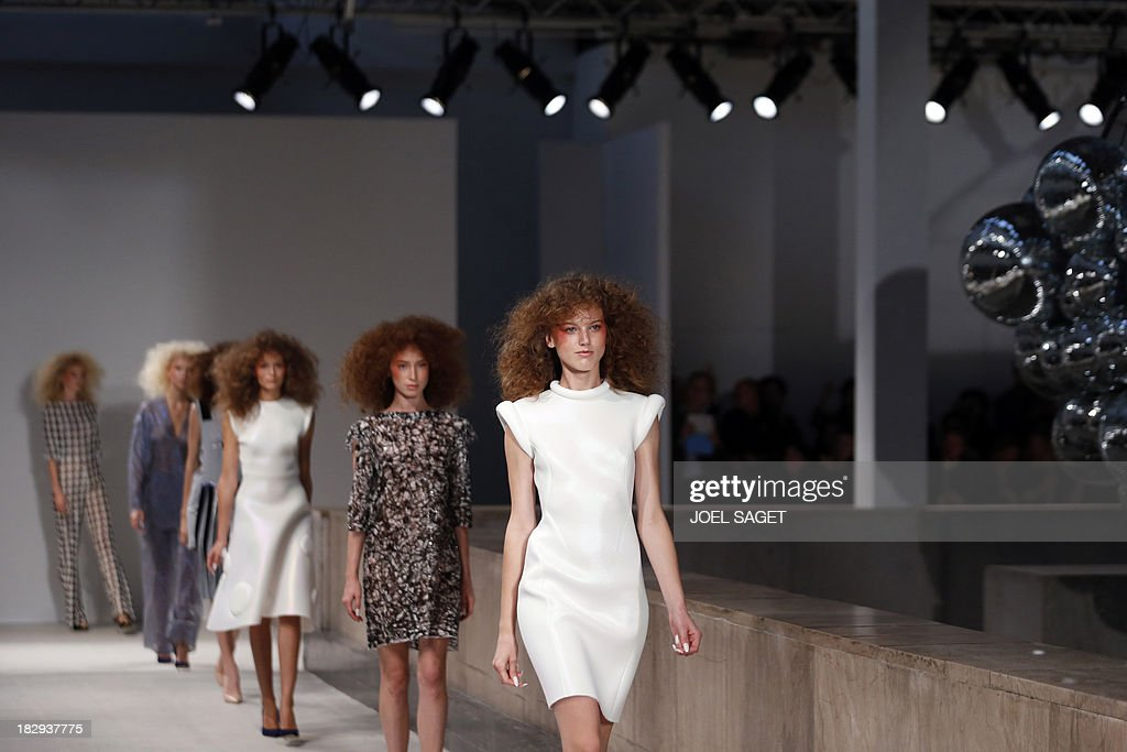 Models present creations by Gosia Baczynska during the 2014 Spring/Summer ready-to-wear collection fashion show, on October 2, 2013 in Paris. AFP PHOTO / JOEL SAGET