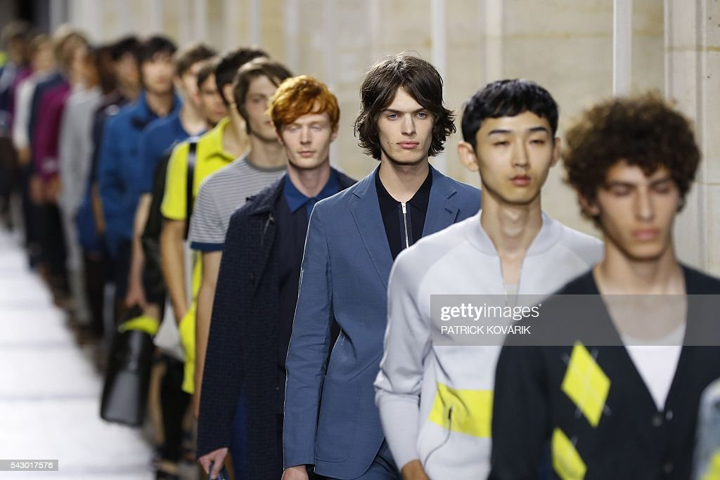 Models present creations by Hermes during the men's Spring/Summer 2017 collection fashion show on June 25, 2016 in Paris. / AFP / PATRICK