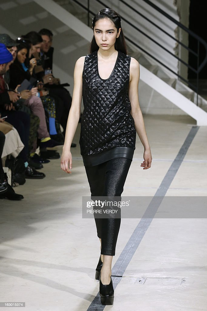 Models present creations by Hexa by Kuho during the Fall/Winter 2013-2014 ready-to-wear collection show, on March 3, 2013 in Paris.