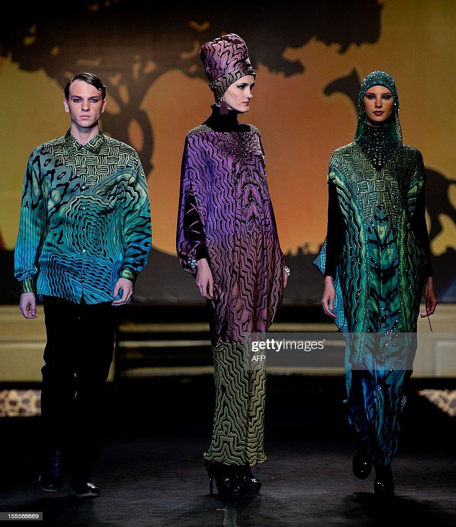 Models present creations by Italian designer Milo Migliavacca on November 5, 2012, during the Islamic Fashion Festival in Kuala Lumpur.