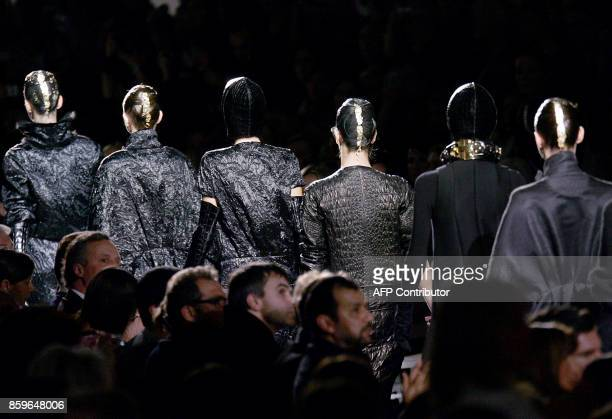 Models present creations by Italian designer Stefano Pilati for Yves Saint Laurent during the Autumn/Winter 2007/2008 readytowear collection show in...