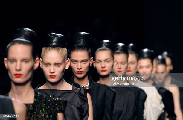 Models present creations by Italian designer Stefano Pilati for Yves Saint Laurent during the autumn/winter 2009 readytowear collection show in Paris...