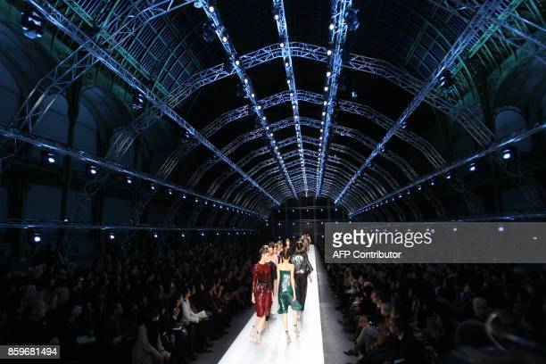 Models present creations by Italian designer Stefano Pilati for Yves Saint Laurent during the spring/summer 2009 readytowear collection show in Paris...
