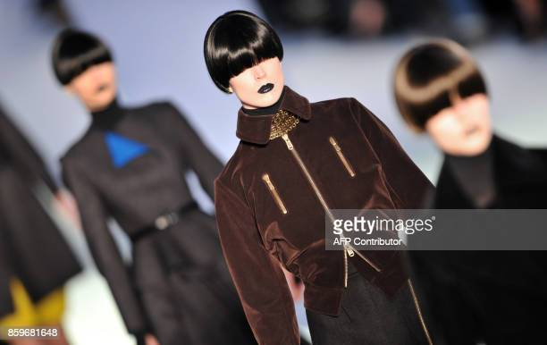 Models present creations by Italian designer Stefano Pilati for Yves Saint Laurent during the autumn/winter 20082009 readytowear collection show in...