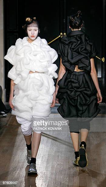 Models present creations by Japanese designer Rei Kawakubo for Comme des Garcons during the autumnwinter 2010/2011 readytowear collection show on...