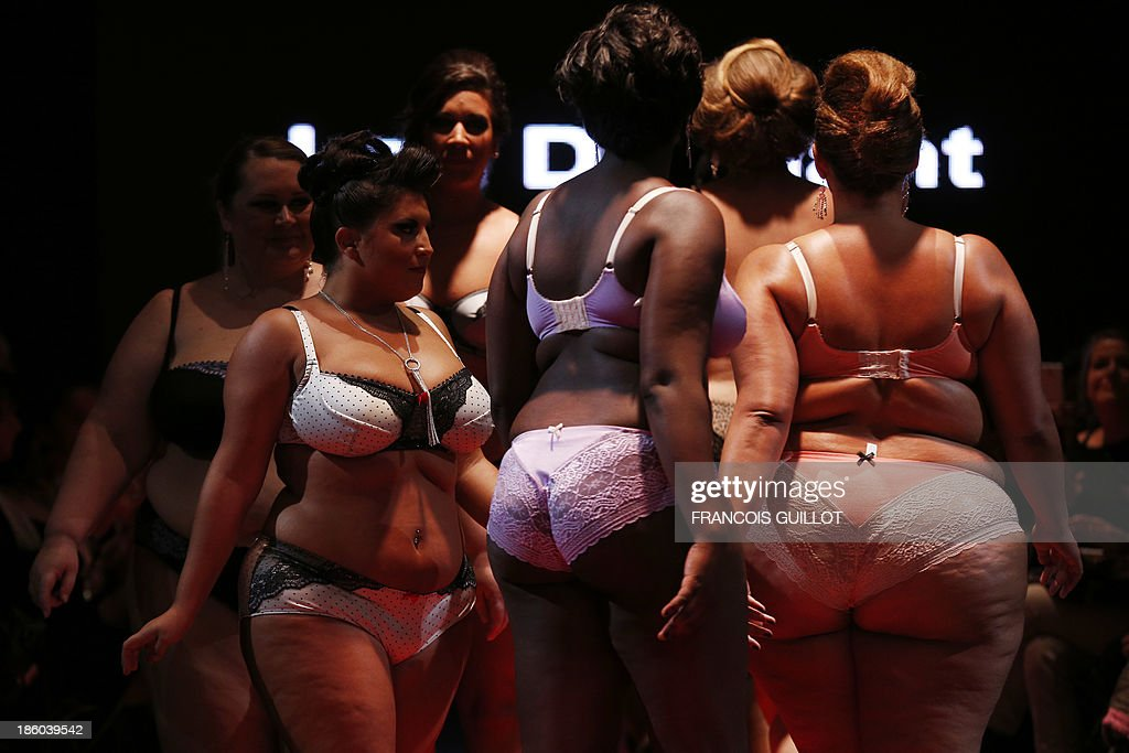 Models present creations by 'La belle affranchie' during the first Pulp fashion week, on October 27, 2013 in Paris.
