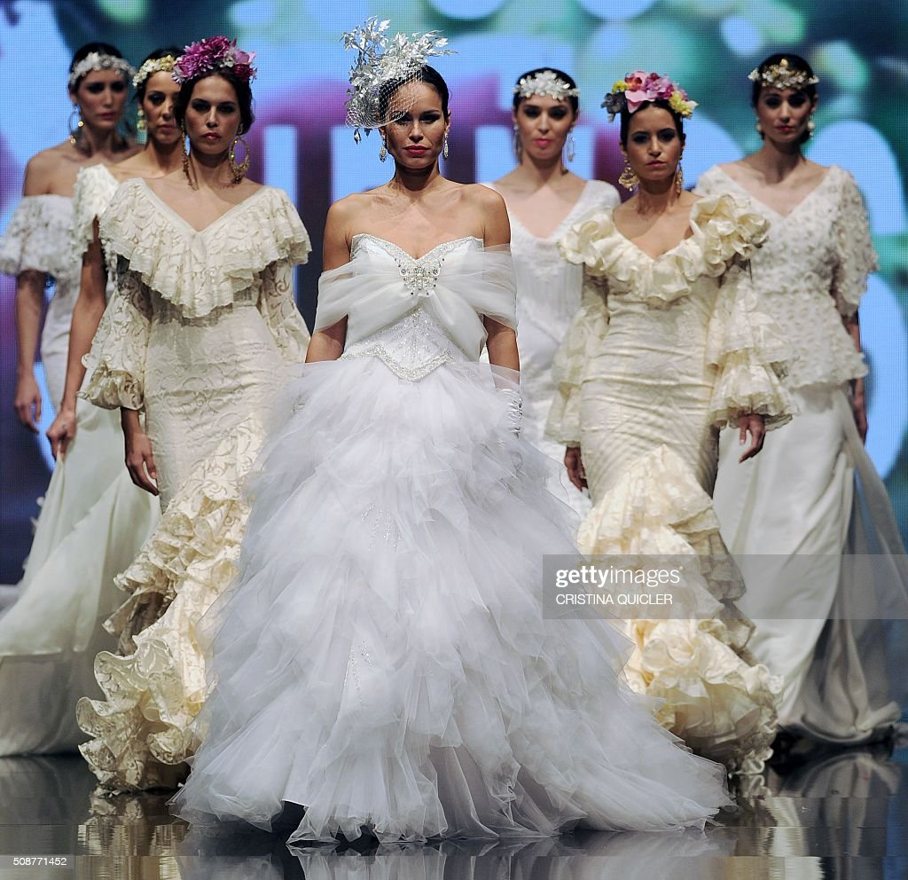 Models present creations by Loli Vera during the SIMOF 2016 (International Flamenco Fashion Show) in Sevilla, on February 6, 2016. AFP PHOTO/ CRISTINA QUICLER / AFP / CRISTINA QUICLER