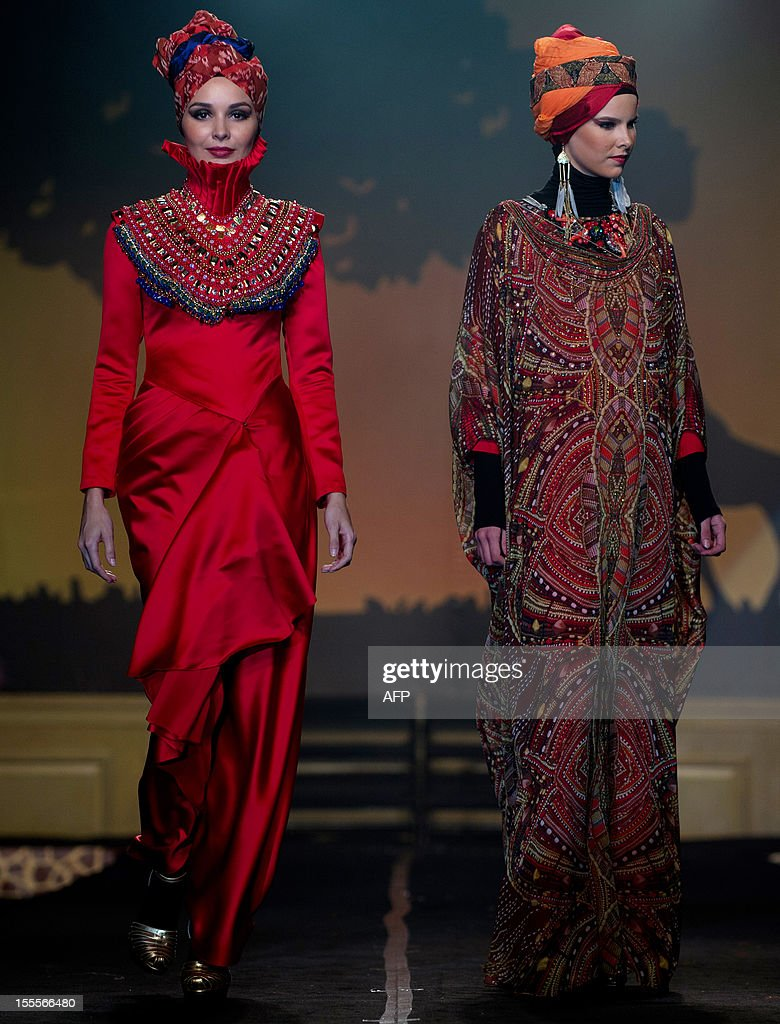Models present creations by Malaysian designer Syaiful Baharim on November 5, 2012, during the Islamic Fashion Festival in Kuala Lumpur.