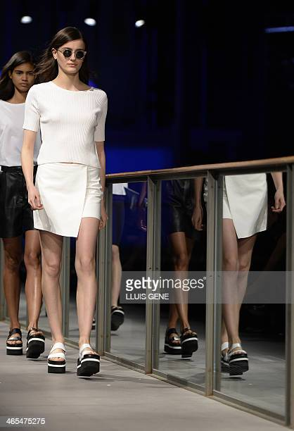 Models present creations by Mango during the 080 Barcelona 'AutumnWinter 20142015' fashion week in Barcelona on January 27 2014 AFP PHOTO / LLUIS GENE