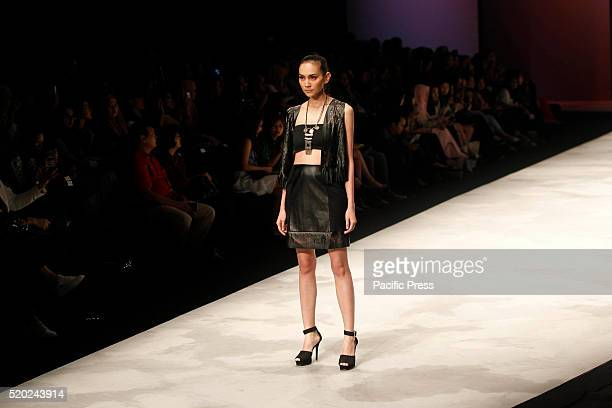 Models present creations by Michelle Tjokrosaputro during the Indonesia Fashion Week Indonesia Fashion Week theme is Reflections of Culture as local...
