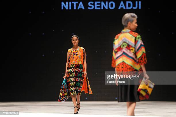 Models present creations by Nita Seno Adji during the Indonesia Fashion Week Indonesia Fashion Week theme is Reflections of Culture as local culture...