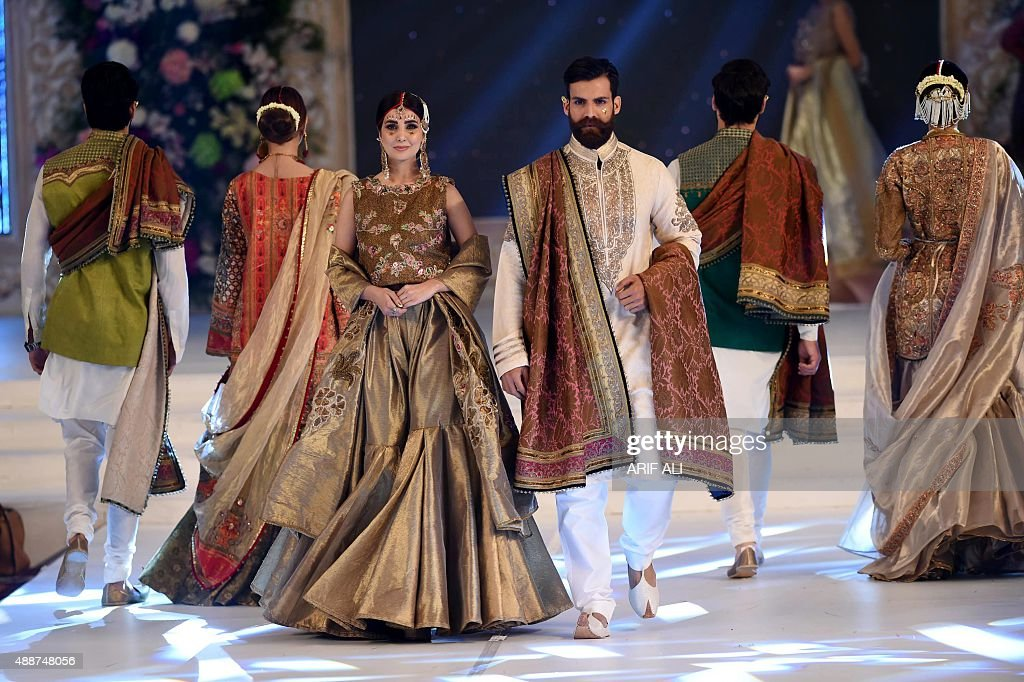 Models present creations by Pakistani designer Fahad Hussayn on the second day of the Pakistan Fashion Design Council L'Oreal Paris Bridal Week in...