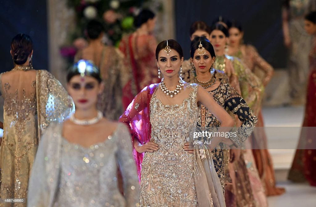 Models present creations by Pakistani designer Nickie Nina on the second day of the Pakistan Fashion Design Council L'Oreal Paris Bridal Week in...
