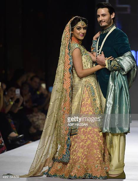 Models present creations by Pakistani designer Wardha Saleem on the second day of the Fashion Pakistan Week in Karachi on November 29 2015 AFP PHOTO...