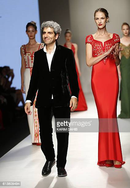 Models present creations by Palestinian designer Jamal Taslaq during the Arab Fashion Week in the United Arab Emirate of Dubai on October 10 2016 /...