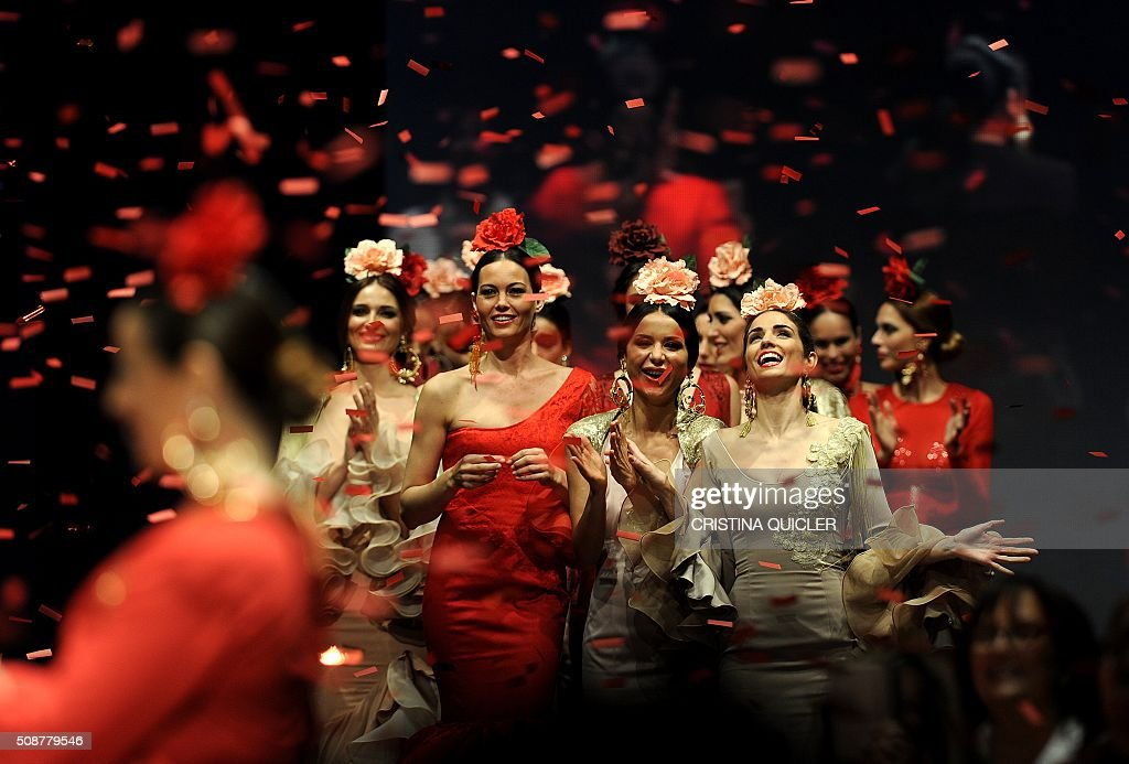 Models present creations by Pilar Rubio during the SIMOF 2016 (International Flamenco Fashion Show) in Sevilla, on February 6, 2016. AFP PHOTO/ CRISTINA QUICLER / AFP / CRISTINA QUICLER
