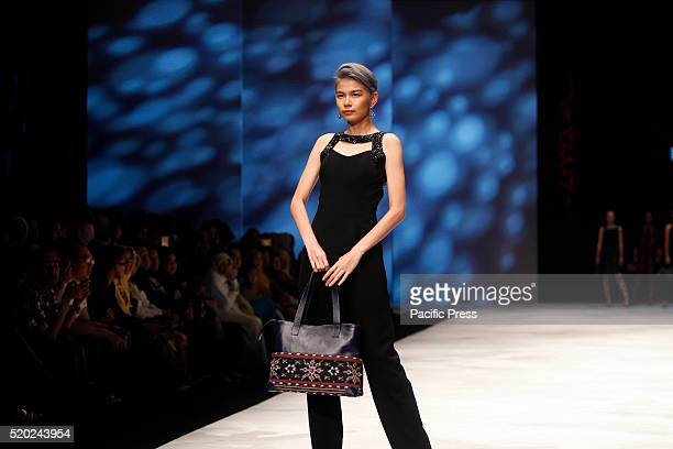 Models present creations by Ria Barbara during the Indonesia Fashion Week Indonesia Fashion Week theme is Reflections of Culture as local culture and...