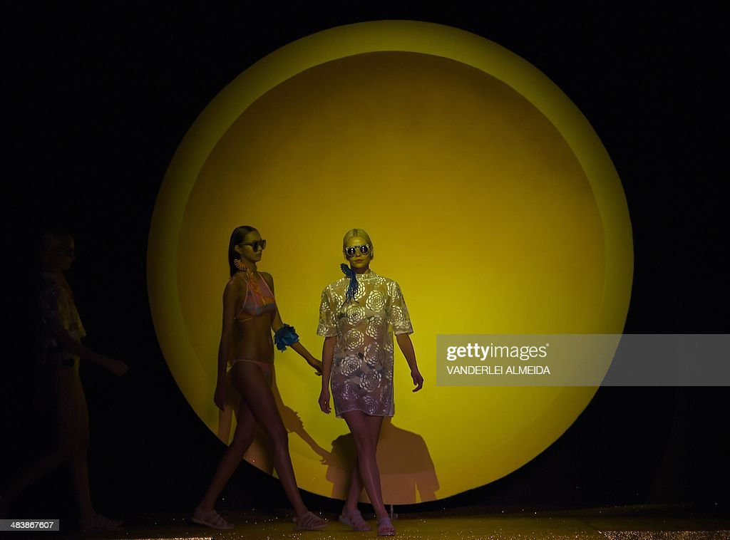 Models present creations by Salinas during the Fashion Rio 2015 Summer collection in Rio de Janeiro Brazil on April 10 2014 AFP PHOTO / VANDERLEI...