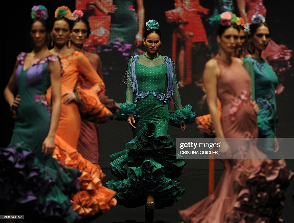 Models present creations by Sara de Benitez during the SIMOF 2016 (International Flamenco Fashion Show) in Sevilla on February 5, 2016. AFP PHOTO/ CRISTINA QUICLER / AFP / CRISTINA QUICLER