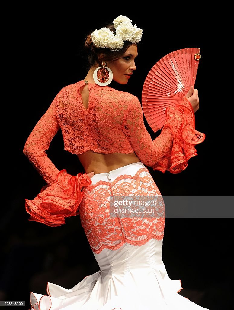 A models present creations by Sara de Benitez during the SIMOF 2016 (International Flamenco Fashion Show) in Sevilla on February 5, 2016. AFP PHOTO/ CRISTINA QUICLER / AFP / CRISTINA QUICLER
