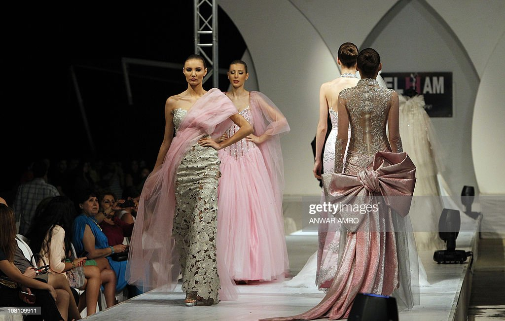 Models present creations by Saudi designer Elham Elyoussef during a fashion show in Beirut on May 5, 2013.
