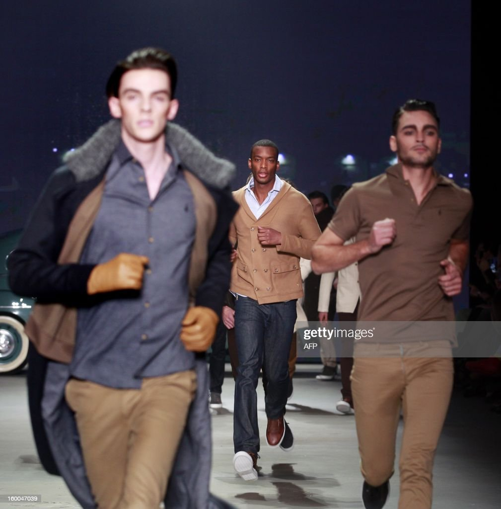 Models present creations by Sjaak Hullekes during the 18th edition of the Amsterdam Fashion Week in Amsterdam, on January , 25 January 2013. The Fashion Week runs from 18 to 27 January.