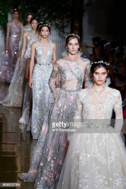 Models present creations by Zuhair Murad during the 20172018 fall/winter Haute Couture collection in Paris on July 5 2017 / AFP PHOTO / FRANCOIS...
