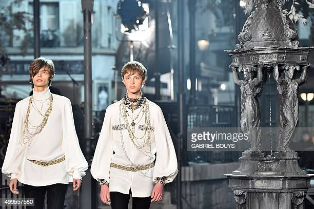 Models present creations during the 12th Chanel Metiers dArt show 'ParisRome' an annual event to honor craftsmanship that artisan partners bring to...