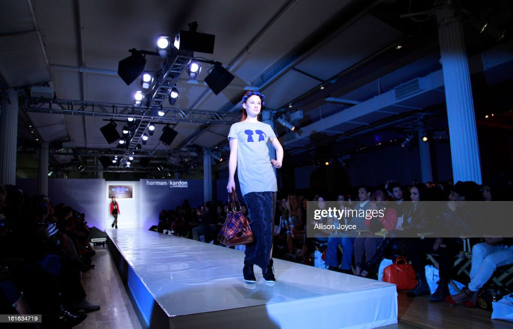 Models present creations during the Boy Meets Girl by Stacy Igel fall 2013 fashion show during Conair Style360 at Metropolitan Pavilion on February 13, 2013 in New York City.