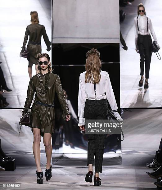 Models present creations during the Mulberry catwalk show at the Autumn / Winter 2016 London Fashion Week in London on February 21 2016 / AFP /...