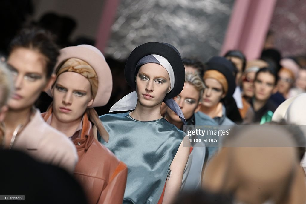 Models present creations for Acne Studios during the Fall/Winter 20132014 readytowear collection show on March 2 2013 in Paris AFP PHOTO/PIERRE VERDY